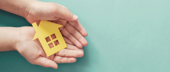 hands holding paper house, family home, homeless housing and home protecting insurance concept,...