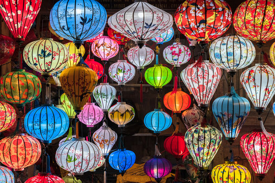 Colorful lanterns spread light on the old street of Hoi An Ancient Town - UNESCO World Heritage Site. Vietnam.