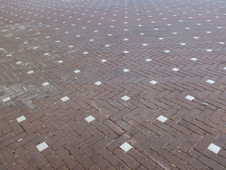 square with a pattern of red and white bricks