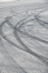 Tire marks in the road from cars doing donuts.