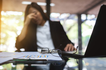 Businesswoman get stressed and headache while having a problem at work in office