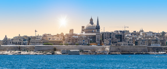 Wall Mural - Valletta, Malta. Panoramic view of city skyline at sunrise.