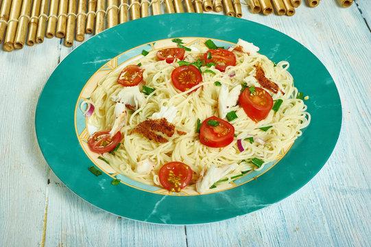 Cod puttanesca with  spaghetti