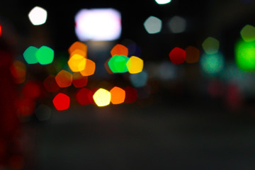 Boogie and night lights dark background.Defocused abstract blur