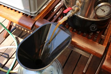 Craft beer being brewed outside. Home brewing concept