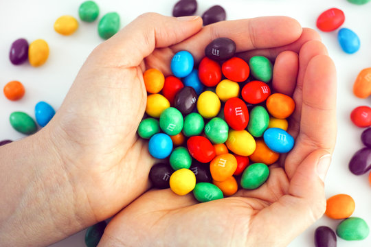 Tambov, Russian Federation - December 05, 2019 M&Ms candy in woman hands.