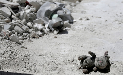 Stuffed toy that belongs to Taher al-Matar's son is pictured at their damaged house in Nairab