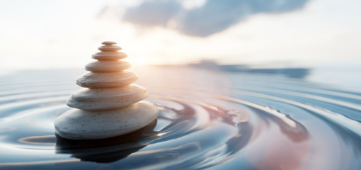 Zen stones arranged in pyramid balanced on water. Spa calm harmony