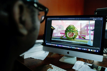 Nigerian filmmaker, Niyi Akinmolayan who created an animated video to educate kids on coronavirus, works on his laptop in his home, amid the spread of the coronavirus disease (COVID-19), in Lagos