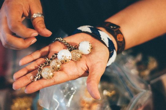Cropped Image Of Hand Holding Beads