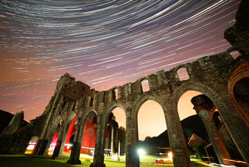 Star trails over Llanthony Priory ruins in Brecon Beacons National Park, Wales