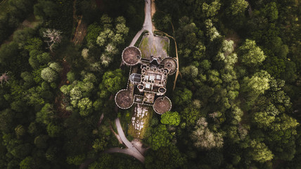 Drone view of stone ancient big castle among green trees and plants