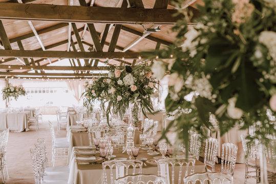 Elegant banquet with flowers under tent