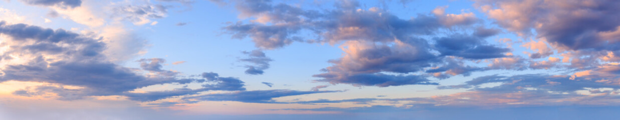 Wall Mural - Summer evening sky panorama with fleece clouds background.