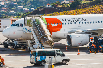 TAP Portugal Airbus A319-111 at Funchal Cristiano Ronaldo Airport, boarding passengers.This airport is one of the most dangerous airports in Europe