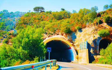 Keuken foto achterwand Lime groen Car on road with underpass in Carbonia Iglesias Sardinia reflex
