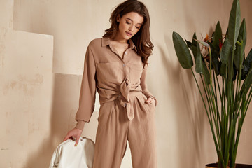 Beautiful brunette woman natural makeup wear fashion clothes casual dress code office style total...