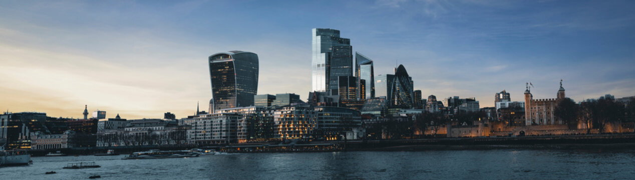 UK, England, London, Panorama of River Thames and downtown skyscrapers at dusk
