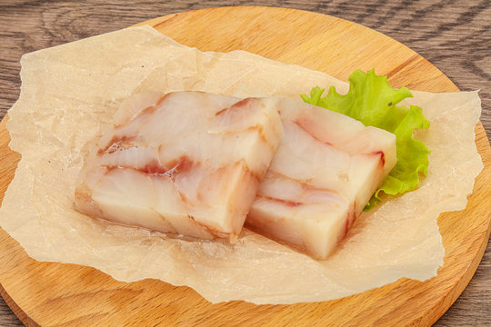 Raw pollock fish fillet for cooking