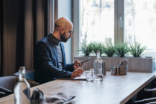 Businessman using smartphone in a cafe