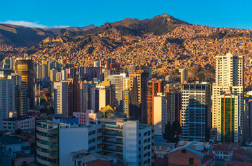 Fotomurales - Cityscape of La Paz with its modern urban skyline and skyscrapers at sunset, Andes Mountains, Bolivia.