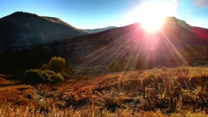 Foto auf Gartenposter Violett rot Countryside Landscape Against Sunlight