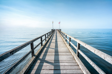 Wall Mural - Wooden pier at the sea
