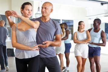 Cheerful   people dancing samba in pairs