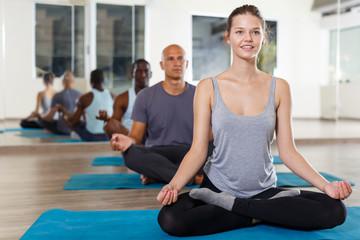 Young girl making yoga meditation in lotus pose