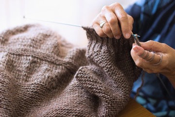 Cropped Image Of Hands Knitting Wool