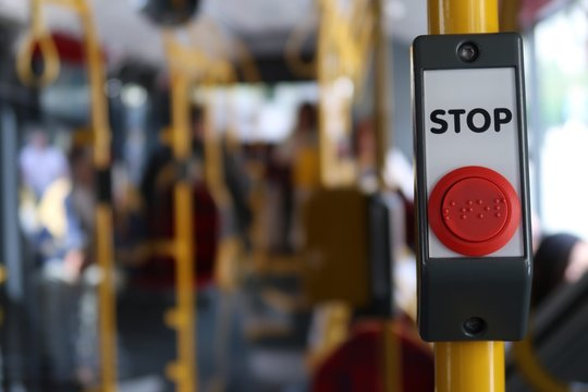 Close-up Of Stop Sign In Bus