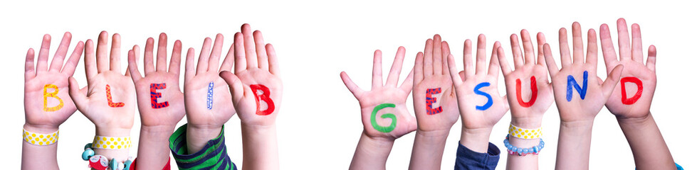 Kids Hands Holding Colorful German Word Bleib Gesund Means Stay Healthy. White Isolated Background