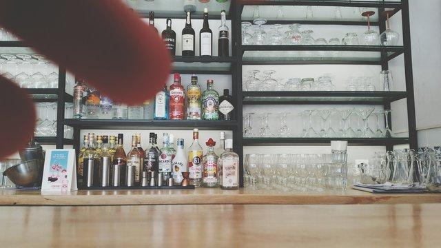 Liquor Bottles On Shelves At Home