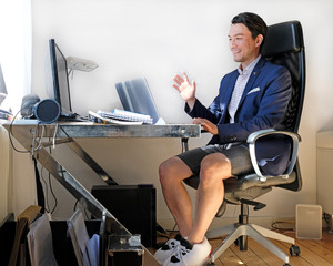 Working from home: man wearing a suit for the video call while also wearing sweatpants