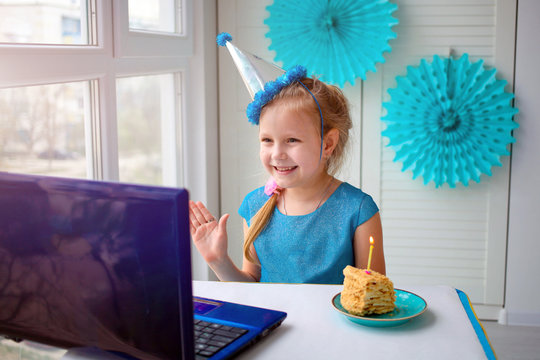 Happy girl  sibling celebrating birthday via internet in quarantine time, self-isolation and family values, online birthday party.