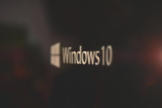 Kiev / Ukraine - 04.07.19: Logotype of Windows 10 on metal surface in selective focus in warm tones