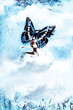 Strange fine art concept. As a picture woman with clouds and butterfly face.