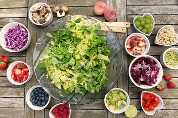 Top view of the fresh ingredients on a wooden table in small bowls