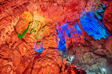 The Reed Flute Cave, natural limestone cave with multicolored lighting in Guilin, Guangxi, China. Fototapete