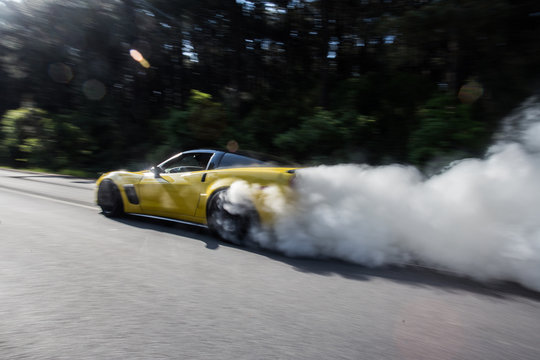 Yellow racing car with red xenon lights, steam ride