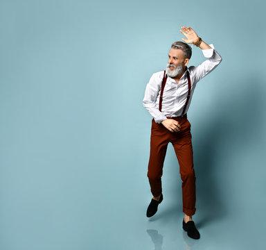 stylish senior man with extravagant clothes