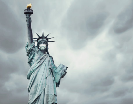 Stock photo of the New York's Statue of Liberty with a mask caused by the coronavirus and copy space