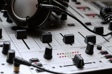 A close up of a professional Dj mixer and headphones.