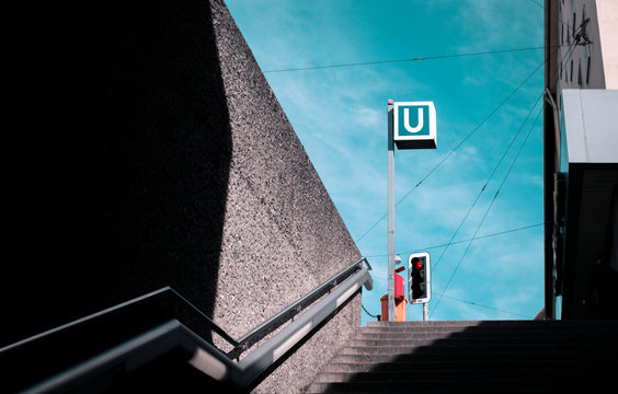 Low Angle View Of Road Sign By Steps Against Sky