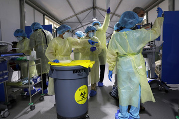 Members of medical staff wearing protective equipment work during testing, amid the coronavirus disease (COVID-19) outbreak, at the Cleveland Clinic hospital in Abu Dhabi