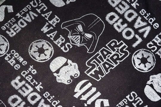 Moscow,  Russia - April, 2020: Fragment of a brand Star wars t-shirt with a signature pattern