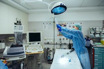 Doctor preparing IV drip in trauma room of a hospital