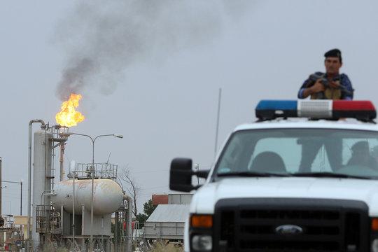 Police patrol in al-Zubair oil field near Basra