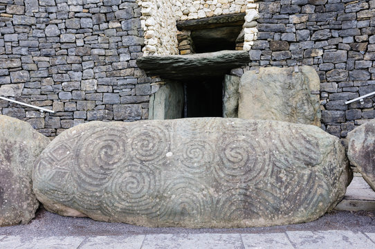 Spiral carvings on a kerb stone at the entrance to Newgrange chambered passage tomb