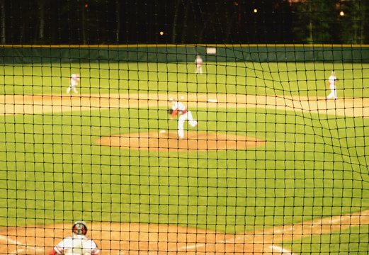 People Playing Baseball On Field